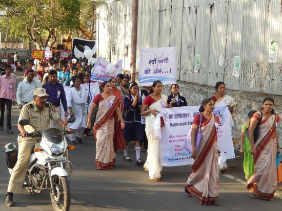 Women marching for a violence free India.