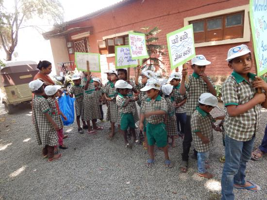 Children marching for prerserving trees & Water